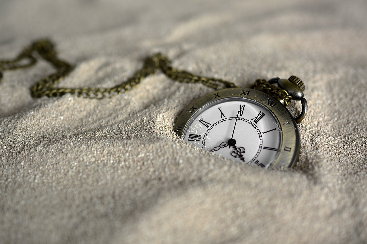 Pocketwatch in Sand