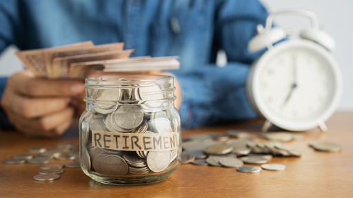 jar with savings labeled retirement with clock in background