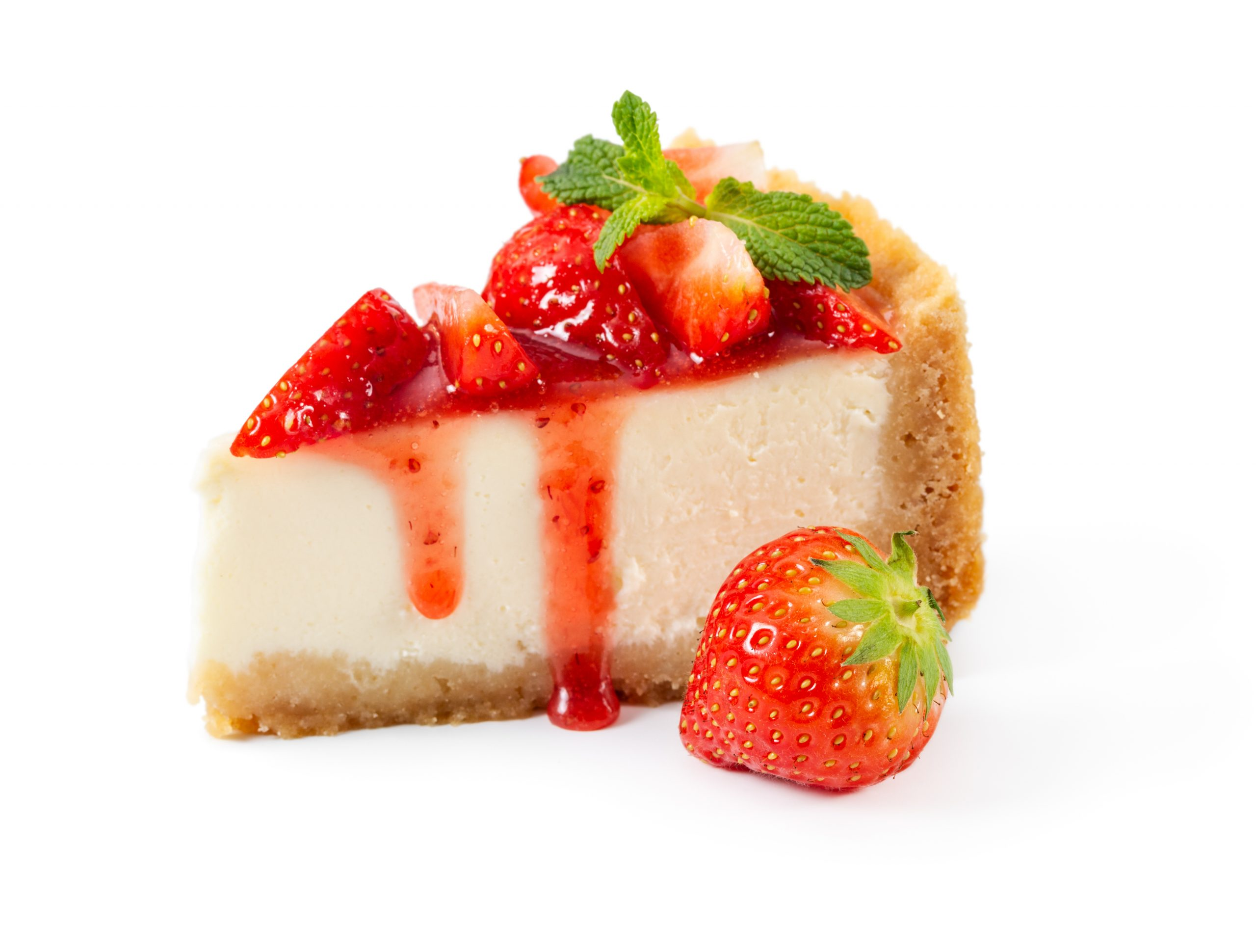 Piece of cheesecake with fresh strawberries and mint isolated on white background